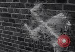Image of Swastika graffiti in Cologne in 1961 and 1935 Nazi boycott Jewish busi Germany, 1961, second 12 stock footage video 65675039876