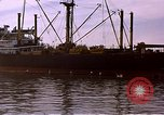 Image of freighter Saigon Vietnam, 1962, second 7 stock footage video 65675039899