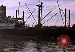 Image of freighter Saigon Vietnam, 1962, second 10 stock footage video 65675039899