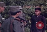 Image of Questioning of Vietcong prisoners by South Vietnamese Officer and U.S. Tuy Hoa South Vietnam, 1962, second 4 stock footage video 65675039916