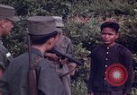 Image of Questioning of Vietcong prisoners by South Vietnamese Officer and U.S. Tuy Hoa South Vietnam, 1962, second 5 stock footage video 65675039916