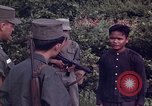 Image of Questioning of Vietcong prisoners by South Vietnamese Officer and U.S. Tuy Hoa South Vietnam, 1962, second 6 stock footage video 65675039916