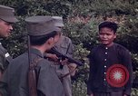 Image of Questioning of Vietcong prisoners by South Vietnamese Officer and U.S. Tuy Hoa South Vietnam, 1962, second 7 stock footage video 65675039916