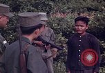 Image of Questioning of Vietcong prisoners by South Vietnamese Officer and U.S. Tuy Hoa South Vietnam, 1962, second 8 stock footage video 65675039916