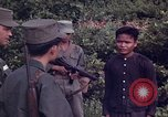 Image of Questioning of Vietcong prisoners by South Vietnamese Officer and U.S. Tuy Hoa South Vietnam, 1962, second 9 stock footage video 65675039916