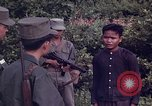 Image of Questioning of Vietcong prisoners by South Vietnamese Officer and U.S. Tuy Hoa South Vietnam, 1962, second 10 stock footage video 65675039916