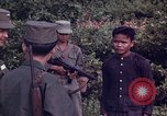 Image of Questioning of Vietcong prisoners by South Vietnamese Officer and U.S. Tuy Hoa South Vietnam, 1962, second 12 stock footage video 65675039916
