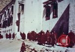Image of monks Lhasa Tibet, 1943, second 8 stock footage video 65675039993