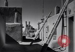 Image of Live and work in Native American Adobe village New Mexico USA, 1948, second 2 stock footage video 65675040095