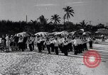 Image of waiters tray race Nassau Bahamas, 1934, second 1 stock footage video 65675040113