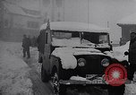 Image of snow capped vehicles Spain, 1957, second 6 stock footage video 65675040125