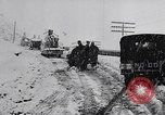 Image of snow capped vehicles Spain, 1957, second 9 stock footage video 65675040125
