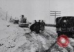 Image of snow capped vehicles Spain, 1957, second 10 stock footage video 65675040125