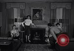 Image of 1950s American family fashions United States USA, 1954, second 6 stock footage video 65675040177