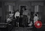 Image of 1950s American family fashions United States USA, 1954, second 7 stock footage video 65675040177