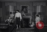 Image of 1950s American family fashions United States USA, 1954, second 8 stock footage video 65675040177