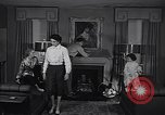 Image of 1950s American family fashions United States USA, 1954, second 9 stock footage video 65675040177
