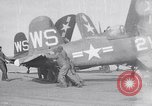 Image of F4U airplanes being moved on USS Badoeng Strait (CVE – 116) Pacific Ocean, 1950, second 1 stock footage video 65675040316