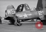 Image of F4U airplanes being moved on USS Badoeng Strait (CVE – 116) Pacific Ocean, 1950, second 2 stock footage video 65675040316