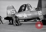Image of F4U airplanes being moved on USS Badoeng Strait (CVE – 116) Pacific Ocean, 1950, second 3 stock footage video 65675040316