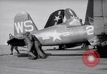 Image of F4U airplanes being moved on USS Badoeng Strait (CVE – 116) Pacific Ocean, 1950, second 4 stock footage video 65675040316