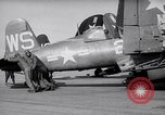 Image of F4U airplanes being moved on USS Badoeng Strait (CVE – 116) Pacific Ocean, 1950, second 7 stock footage video 65675040316