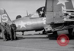 Image of F4U airplanes being moved on USS Badoeng Strait (CVE – 116) Pacific Ocean, 1950, second 9 stock footage video 65675040316