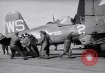 Image of F4U airplanes being moved on USS Badoeng Strait (CVE – 116) Pacific Ocean, 1950, second 11 stock footage video 65675040316