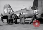 Image of F4U airplanes being moved on USS Badoeng Strait (CVE – 116) Pacific Ocean, 1950, second 12 stock footage video 65675040316