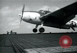 Image of US Navy TBM aircraft landing on carrier Pensacola Florida USA, 1945, second 11 stock footage video 65675040337