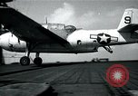 Image of US Navy TBM aircraft landing on carrier Pensacola Florida USA, 1945, second 12 stock footage video 65675040337