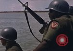 Image of Navy Riverine boats and helicopters engage Viet Cong South Vietnam, 1967, second 11 stock footage video 65675040360