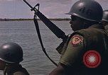 Image of Navy Riverine boats and helicopters engage Viet Cong South Vietnam, 1967, second 12 stock footage video 65675040360