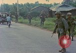 Image of US Army soldiers in field Vietnam, 1968, second 6 stock footage video 65675040364