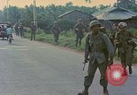 Image of US Army soldiers in field Vietnam, 1968, second 7 stock footage video 65675040364