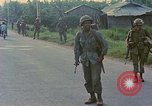 Image of US Army soldiers in field Vietnam, 1968, second 8 stock footage video 65675040364