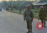 Image of US Army soldiers in field Vietnam, 1968, second 9 stock footage video 65675040364