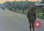 Image of US Army soldiers in field Vietnam, 1968, second 11 stock footage video 65675040364