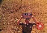 Image of Scenic view of a village Vietnam, 1965, second 5 stock footage video 65675040375