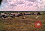 Image of Scenic view of a village Vietnam, 1965, second 9 stock footage video 65675040375