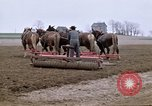 Image of Farmer with horses and mules plows field New York United States USA, 1970, second 6 stock footage video 65675040536