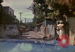 Image of narrow streets Kingston Jamaica, 1972, second 2 stock footage video 65675040554