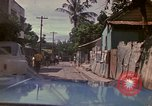 Image of narrow streets Kingston Jamaica, 1972, second 3 stock footage video 65675040554