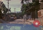 Image of narrow streets Kingston Jamaica, 1972, second 5 stock footage video 65675040554