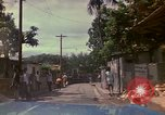 Image of narrow streets Kingston Jamaica, 1972, second 6 stock footage video 65675040554