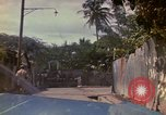 Image of narrow streets Kingston Jamaica, 1972, second 9 stock footage video 65675040554
