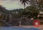 Image of narrow streets Kingston Jamaica, 1972, second 11 stock footage video 65675040554