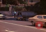 Image of Busy street Montego Bay Jamaica, 1972, second 9 stock footage video 65675040556