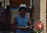 Image of Jamaican nurse Jamaica, 1972, second 6 stock footage video 65675040559