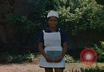 Image of Jamaican nurse Jamaica, 1972, second 4 stock footage video 65675040561